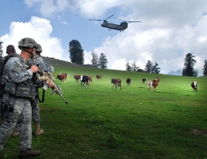 Photo taken in Nuristan and was part of a US Army press release. Flying through the clouds soldiers from the Afghan National Army and Task Force Saber air-assaulted onto landing zone Shetland July 19 during Operation Saray Has. The landing zone is located in a large meadow near the top of a mountain in Nuristan where local Afghans use the area as a grazing pasture for livestock.